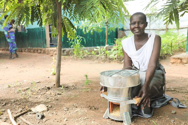 Abamoltho cooks for her five children using her Eco stove in a refugee camp. Photo: Jennifer Nolan