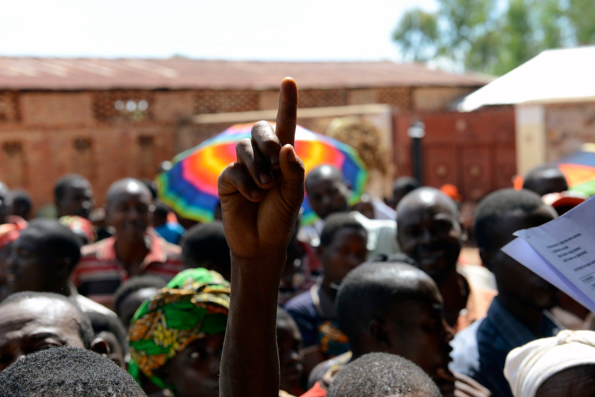 Jean-Marie Mbonimpa (30) has just received news at a public meeting held outside Muhuzu primary school in Busoni that he has been selected to take part in a new phase of Concern's graduation programme. Photo: Chris de Bode/Panos Pictures for Concern Worldwide