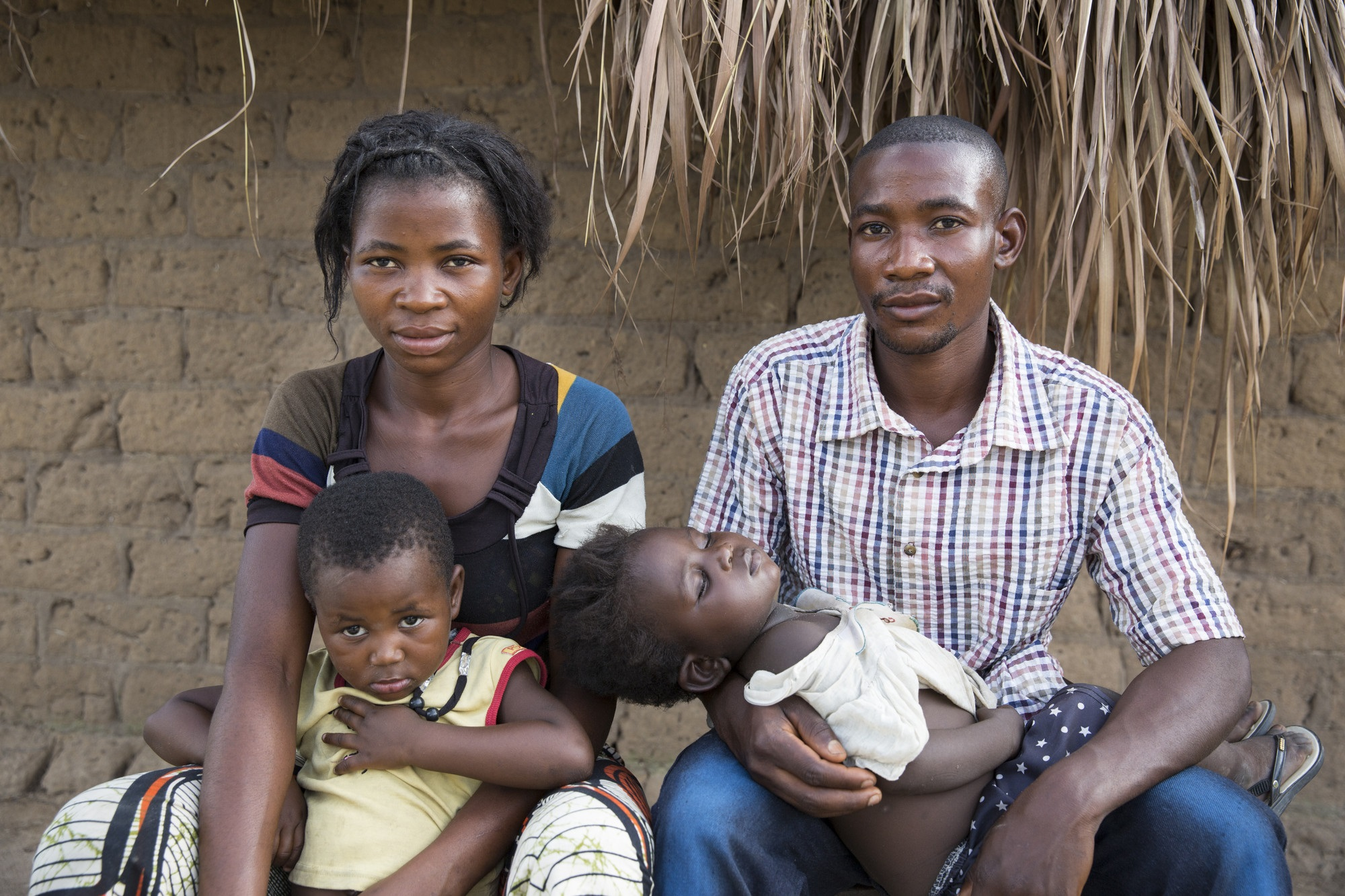 The home of Mbuya Reagan, 27 (a casserite miner) and his wife, Banze Therese, 25 and their three children in Manono, DRC. They are benefitting from Concern's graduation program. Photo: Kieran McConville/ Concern Worldwide