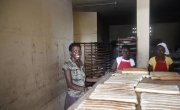 Christela Louis inside the bakery (supported by Concern) where she has worked since May. Christela is confident that through working here, she will be able to grow her business and start saving money. Photo: Kristin Myers /Concern Worldwide.