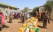 Hundreds of people waiting for a weekly water truck to arrive in Kersa Dula, Somali Region, Ethiopia. The people here get an average of 20 liters of water per person for one week, very far below the UN standards. Photo: Jennifer Nolan/ Concern Worldwide