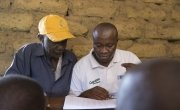 Principal of Masaka School, Mohamed A Kamara, with Alpha Abu Kamara of Concern Worldwide Sierra Leone. Photo: Kieran McConville/Concern Worldwide.