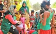 Hasina Rahman visiting a host community at Tanjimarkhola OTP centre, Bangladesh. Photo: Tariq Adnan / Concern Worldwide.