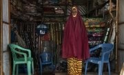 In Medina Market, Somalia, Hodan*, a member of the Self-Help Group (SHG) supported by CONCERN, is seen in her shop. She sells mattress, pillows chairs, flowers, mosquito nets. Photo: Marco Gualazzini/ Concern Worldwide.
