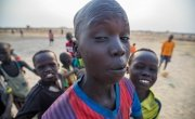 Kids goofing around in front of the camera while they take a small break from their soccer game in Bentiu's PoC. Photo: Steve De Neef / Concern Worldwide.