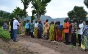 Concern Rwanda staff talk to beneficiaries of the Farmer Field Schools in Gishubi Sector, Gisagara District. Photo: Donna Ajamboakaliza / Concern Worldwide.