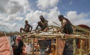 Rohingya men rebuilding their tents before the monsoon arrives, Jamtoli, Ukhiya, Bangladesh.  Photo: Abir Abdullah/Concern Worldwide