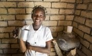 15 year old Liliana Mwenza wa llunga says the new water point and other interventions by the Concern-led WASH consortium in her village, Mulombwa, has had a very positive impact on family life. DRC. Photo: Kieran McConville/ Concern Worldwide