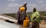 Women collect water from an underground tank. Photo: Eamon Timmins/Concern Worldwide