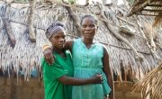 """Nadine Doko and Hermine Kounougoue are friends and neighbours. Hermine and her four children have learned a lot about food preparation and hygiene from Nadine, who's a Concern-supported Mama Lumiere - or 'lead mother'. """"I have learned a lot from her,"""" said Hermine. """"Much has changed in my life. I think that all my children are healthy because of the advice I've received from her."""" Photographer: Chris de Bode"""