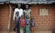 Estella Bissabogoyo (28) with her husband Gustave (31) and four of their children Jordy (8), Israella (4), Corine (3) and Jupsie (2) outside their home in the village of Gbadengue. Estella is part of a village seed group to receive seeds, tools and technical assistance from Concern. Photographer: Chris de Bode