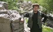 Joma Khan, by the remains of his home in Northeastern Afghanistan, which was destroyed by a flash flood in 2014. Concern has suppported the community to establish watershed protection on the vulnerable hillsides, to prevent further erosion and landslides. Photo: Kieran McConville / Concern Worldwide