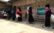 Mothers maintaining social distancing while waiting to receive Nutritional Supplement from a Concern-supported site, Cox's Bazar, Bangladesh. Photo: Md. Al-Nasim