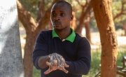 Samson Ngoma, demonstrating proper handwashing using soap, Malawi Photo: Henry Mhango