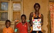 Shyreen with her sons Ramsy and Leonard after receiving soap and Covid-19 fliers from Concern.