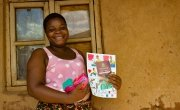 Janet Bosko Jasad receives soap and Covid-19 fliers as part of a Concern Worldwide distribution.