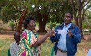 Chrisy Kumvula and Paul Chitsuro, demonstrating to participants on the proper use of masks. Malawi Photo: Henry Mhango