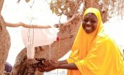 Hadiza demonstrations good hand washing technique she was taught at a Covid-19 awareness and soap distribution in Tahoua, Niger. Photo: Marie Rabo