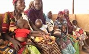 Mothers waiting with their children to be seen by the health worker during the annual peak in SAM and malaria service demand (September). Affala Health Centre in Tahoua District, Niger 2018. Photo: Concern Worldwide.