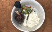 A bowl of mashed cassava, palm nuts, avocados, mushrooms and tomatoes that Natalie Wato's family have bought for their evening meal. Photo: Chris de Bode