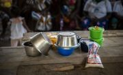 Locally grown ingredients such as sesame paste, powered okra, mashed banana and porridge oats are used for a cookery demonstration at a Mothers' Group. Photo: Nora Lorek