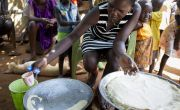 Idil* is cooking Kisro (paper food). She lives in a POC camp in Juba, South Sudan. Photo: Abbie Trayler-Smith