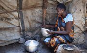 Dukan* lives with her family in a POC in Juba, South Sudan. Here, she is cooking Walwal. Photo: Abbie Trayler-Smith