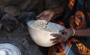 Dukan* is cooking Walwal which is a grain a bit like millet and is cooked with water. Photo: Abbie Trayler-Smith