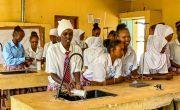 Bati with her classmates in the Science lab at Kalacha Nomadic Girls School. Kenya Photo: Jennifer Nolan