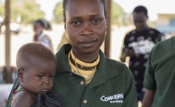 14 month old Chan Adim Garang and Monica Mawien. Photo: Kieran McConville/Concern Worldwide