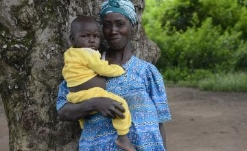 Jabelle Yafiti with her daughter, Aime-Lazara (16 months) who was malnourished but has recovered after receiving treatment at the Concern supported Boudouli Heath Post.  Photo: Chris de Bode