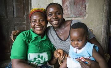 Maternal and Newborn Health Promoter Kai Jigba with a Concern-trained former traditional birth attendant Maddie Sanoh and baby Mamie. Photo: Kieran McConville / Concern Worldwide.