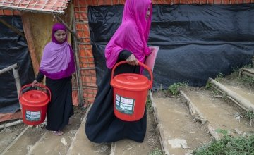 40-year-old widow Tayma* receives a dignity kit from Concern. It consists of a torch, bucket and lid, soap, flip flops, shawls, underwear and sanitary pads. Photo: Abir Abdullah/ Concern Worldwide