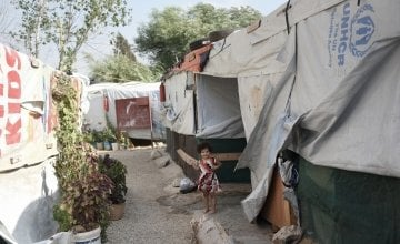 The tented encampment which is home to *Mohamad and his family, which has been kitted out with water tanks and insulation for the winter, by Concern, in Northern Lebanon. Photograph by Mary Turner