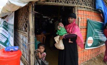 Arshia holds baby Aklima in Cox's Bazar. Photo: Darren Vaughan / Concern Worldwide