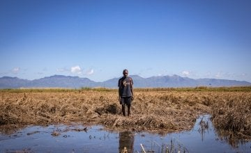 Recently married Patrick Ghembo of Monyo Village, Malawi, standing in his field, destroyed by the floods. Patrick is a farmer of maize and rice. He and his wife must rely solely on fishing until he can plant again. They will stay at the displacement camp until the floods have fully subsided. Photo: Gavin Douglas