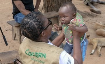 Concern Program Manager Akunsito Kananji with Baby David in Malawi. David's family home was washed away with all their belongings. David's family are casual labourers. With no crops to harvest, his parent won't have any work this season. Photo: Gavin Douglas