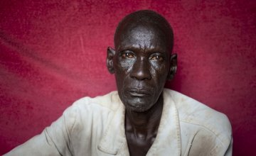 Nasil* lives with his brother Gatlit* in one room with their children. Photo: Abbie Trayler-Smith