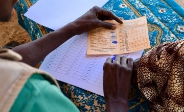 300 vulnerable women from Sarkeki receive a money transfer and fortified flour. Photo: Darren Vaughan/Concern Worldwide