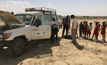 The Concern team stop to fix a puncture. Photo: Darren Vaughan/Concern Worldwide.