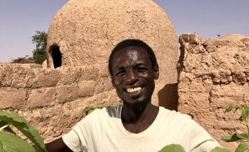 Mika Abu with his vegetable sacks full of amaranth leaves. Photo: Darren Vaughan/Concern Worldwide