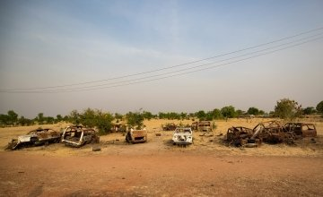 Empty and damaged building and cars are a reminder of the recent conflict in Bentiu Town, South Sudan. Photo: Steve De Neef
