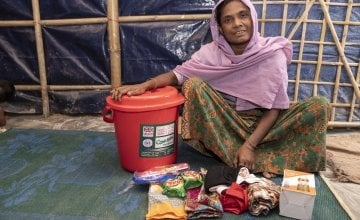 40-year-old widow Tayma* receives a dignity kit from Concern. It consists of a torch, bucket and lid, soap, flip flops, shawls, underwear and sanitary pads.