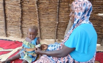 Khamissa, here with her daughter, is a Concern-trained Community Health Volunteer in Doroti, Chad. Photo: Lucy Bloxham