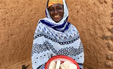 Diaba shows off some of the 600 bars of soap she and other women have made in the past three months. Photo: Darren Vaughan