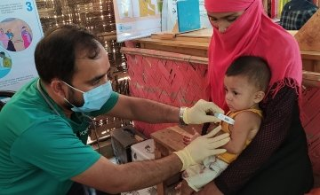 A paramedic is checking the temperature of 8 month old, Arman* in Cox's Bazar, Bangladesh. Photo: Rajib Kumar Kundu