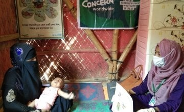 A nutrition counsellor helps a mother and her baby in Cox's Bazar, Bangladesh