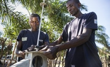 Pump technician, Ilunga Wailungabje (left), and supervisor Daviens Ngoy Wangay (right), doing maintenance work on a water pump in Katchambuyu village, Tanganyika, DRC, September 2017