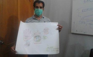 Ejaz Afzal with his artwork, Pakistan