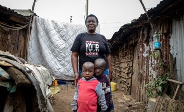 Elizabeth Oduor from Nairobi with two of her young clients from an informal childcare centre in Mathare, Nairobi. Photo: Gavin Douglas